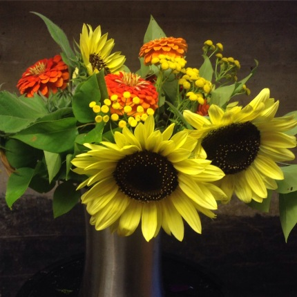 fall yellow and orange sunflower arrangement