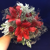 red lilly and white bridal bouquet